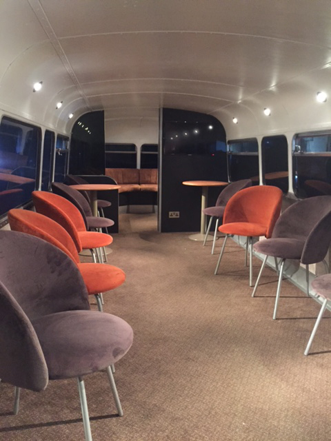 brown and orange seating static bus hire