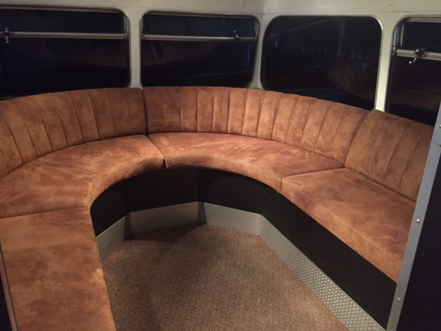 brown settee seating static bus hire