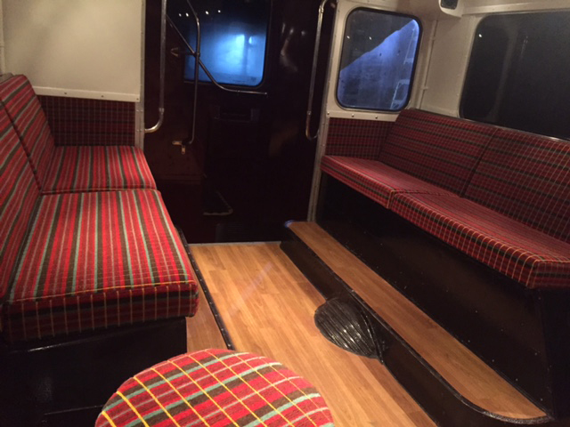 patterned seats with wooden floor static bus hire