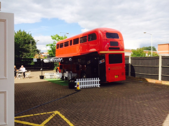 red bus black and white balloons with canopy static bus hire