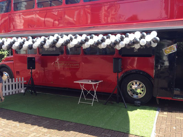 red bus black and white balloons static bus hire