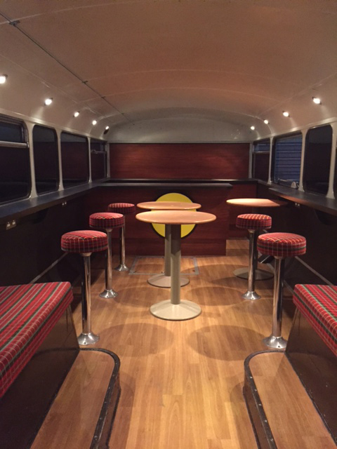 stools and tables on wooden floor static bus hire