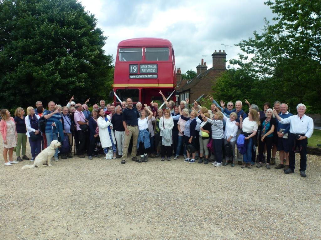 graham wood and his guests pictured in front of route-master hire red London bus
